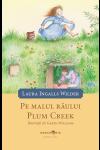 """Pe malul râului Plum Creek - seria """"Căsuța din prerie"""", vol. 4"""